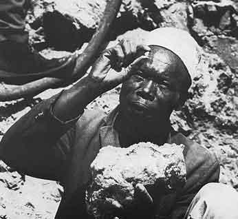 Miner Examining Tanzanite Crystal photo image