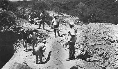 Miners Working a Merelani Vein Under Watchful Eye of Armed Guard