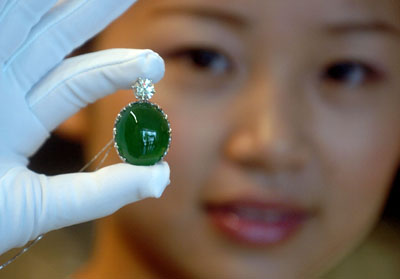 Saleswoman Displays Emerald Pendant photo image