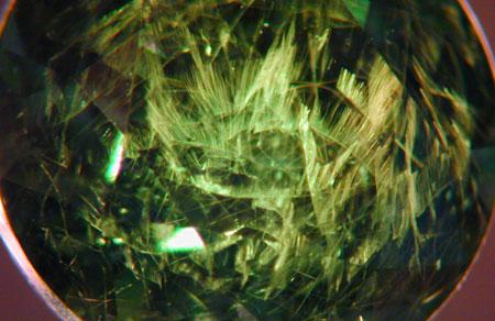 Demantoid Garnet photomicrograph image