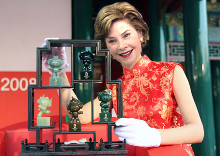 Laura Bush Examines Fuwa photoshop image