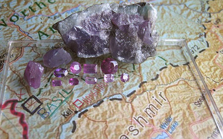 Rough and Cut Purple Sapphires on Map photo image